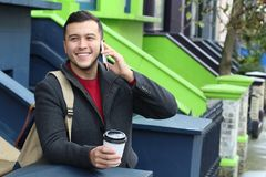 Gentleman calling by phone outdoors.  Stock Photos
