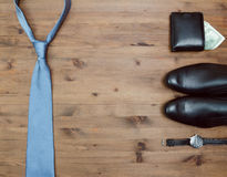Gentleman concept. tie dollars watches and shoes Stock Images