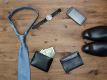 Gentleman concept. tie dollars watches smartphone and shoes Stock Image