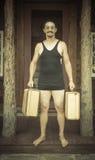 Gentleman Dressed in 1920's Era Swimsuit Holding Suitcases on Stock Photos