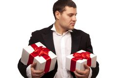 Gentleman with gift boxes Stock Photos