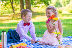 Gentleman and a happy little lady on a date Stock Images