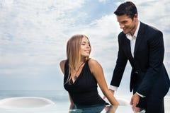Gentleman helping his girlfriend Stock Photography