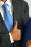 Gentleman with his thumb up. Signaling success Royalty Free Stock Photography