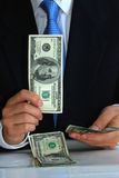 A gentleman holding the $100 bill like flipping pl Stock Image