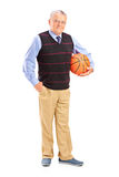 Gentleman holding a basketball Stock Photography