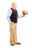 Gentleman holding a bunch of flowers Royalty Free Stock Photo