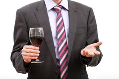 Gentleman holding a glass of wine. Royalty Free Stock Photography