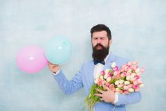 Gentleman making romantic surprise for her. Flowers delivery. Gentleman romantic date. Birthday greetings. For someone. Special. Man bearded gentleman suit bow royalty free stock photos