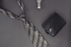 Gentleman. Men`s tie wallet watch. On a dark background Royalty Free Stock Images