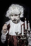 Gentleman rococo era wig, chandelier with candles. Gentleman rococo era wig, man dressed in vintage Stock Photos