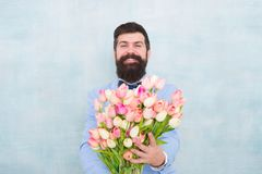 Gentleman romantic surprise for her. Flowers delivery. Gentleman romantic date. Birthday greetings. Best flowers for. Girlfriend. Spring holiday. Man bearded stock photo