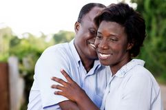Happy young couple embracing. Stock Images