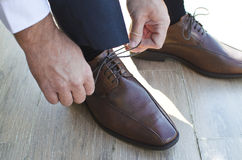 Gentleman shoes. Brown gentleman shoes on wooden ground Stock Photo
