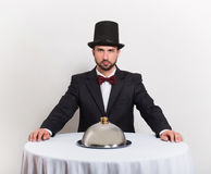 Gentleman sitting at the table Royalty Free Stock Photography