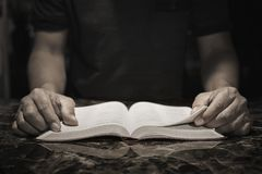 Gentleman studying the Bible in his office. Church Concept Stock Photos