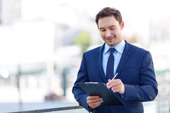 Gentleman in suit using a clipboard Royalty Free Stock Photo