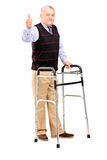 Gentleman using walker and giving a thumb up Stock Photo