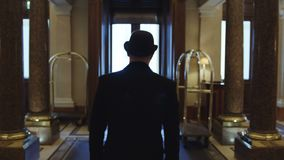 Gentleman walking in a hall stock footage