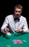 Gentleman in white shirt, playing cards Stock Photo