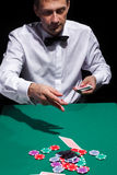 Gentleman in white shirt, playing cards Stock Images