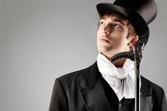Gentlemen. Portrait of a young gentlemen wearing dinner jacket and black top hat. Shot in a studio royalty free stock photos