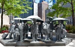 Gentlemen. This is a Summer picture of a public art sculpture titled Gentlemen on display at the AMA Plaza located in Chicago, Illinois. This bronze sculpture of royalty free stock photography