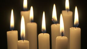 Gently burning candles stock footage