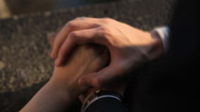 Gently connected hands of a newly-married couple stock footage