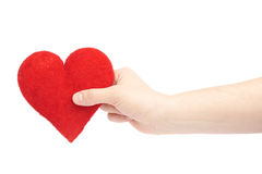 Gently holding plush red heart isolated Royalty Free Stock Photography