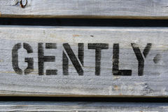 GENTLY stencilled in capitals on wood Royalty Free Stock Image