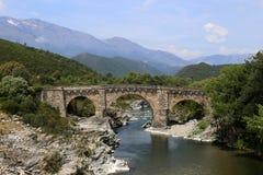Genuese bridge crossing river Tavignano, Corsica, France royalty free stock photography