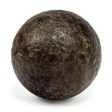 Genuine 18th century cannonball  on white Stock Photos