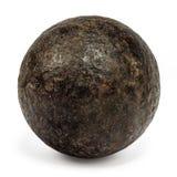 Genuine 18th century cannonball on white stock photos