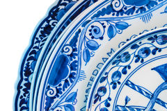 Genuine ancient Dutch blue and white porcelain dishware. With text Amsterdam Stock Photos