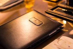 Genuine Brown Leather Folder on Shiny Desk Surface stock photography