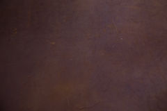 Genuine brown textured cow leather background Stock Images