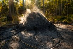 A genuine coal pit where charcoal is being made. In a traditional way Royalty Free Stock Photo