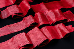 Genuine cobra snakeskin leather, snake skin, texture, animal, reptile on a black background. Royalty Free Stock Photos