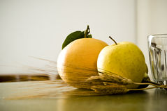 Genuine food concept. Orange, apple, bead and water, all genuine food Stock Images