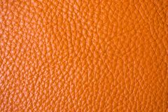 Genuine full grain leather tan color colose up background. Cowhide for crafsman Stock Photography