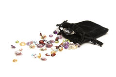 Genuine Gemstones. A spilled pouch of genuine gemstones of various colors and minerals Stock Photo