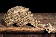 Genuine barrister's wig. Genuine horsehair barrister's wig on an antique desk Royalty Free Stock Images