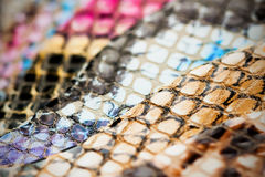 Genuine leather, color samples with Texture under the skin exotic reptile for fashion industry. Selective focus Stock Photo