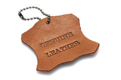 Genuine leather label. Printed text burned into a piece of skin Royalty Free Stock Image