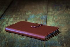 Genuine leather smartphone case cover. In vintage Royalty Free Stock Photography