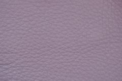Genuine leather texture, pink lilac color, matte surface, trendy background. Ideal for clothing, footwear, handbags. Concept of shopping, manufacturing, modern Royalty Free Stock Image