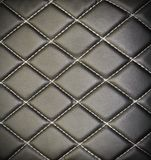 Genuine leather upholstery background. For a luxury decoration in black tones Stock Image