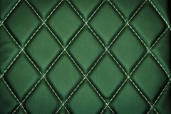 Genuine leather upholstery background. For a luxury decoration in green tones Stock Images