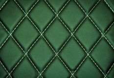 Genuine leather upholstery background. For a luxury decoration in green tones Stock Photo